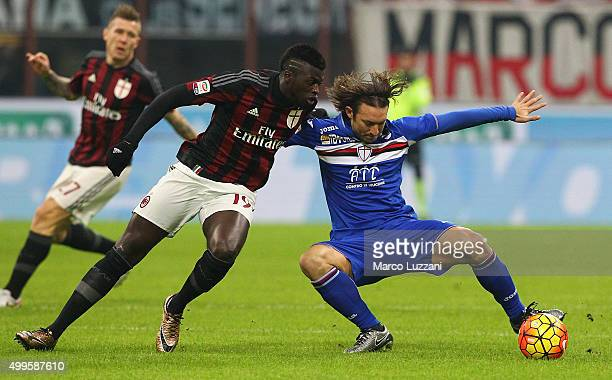 Edgar Osvaldo Barreto of UC Sampdoria competes for the ball with M Baye Niang of AC Milan during the Serie A match between AC Milan and UC Sampdoria...