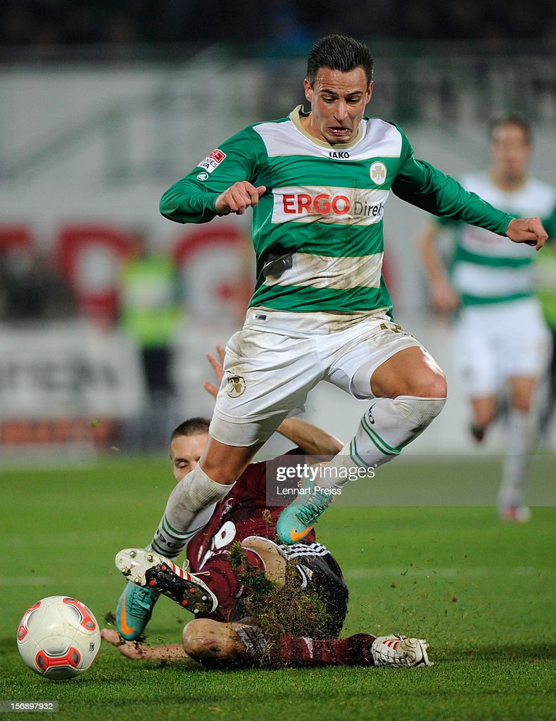 Edgar Prib (R) of Fuerth challenges Timmy Simons of Nuernberg during the Bundesliga match between SpVgg Greuther Fuerth and 1. FC Nuernberg at Trolli-Arena on November 24, 2012 in Fuerth, Germany.