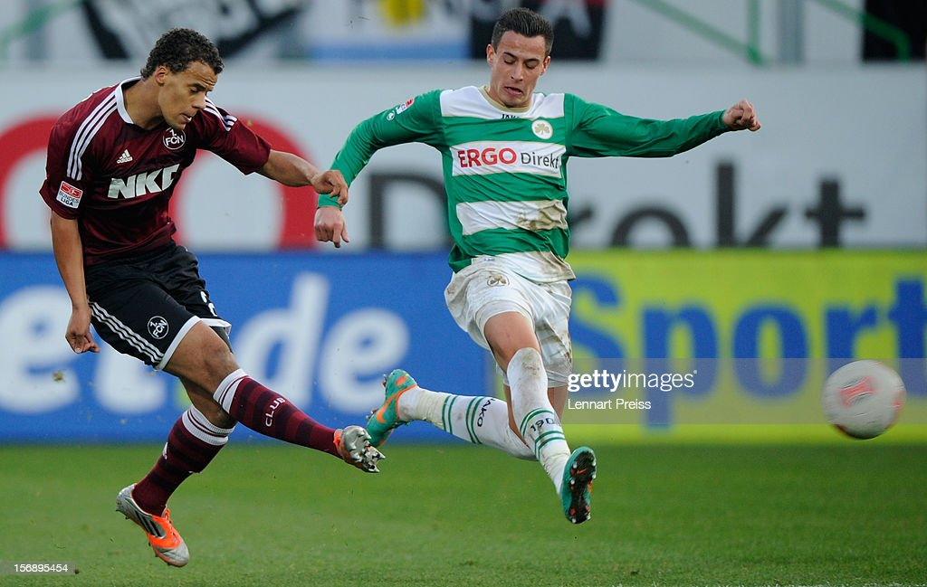 Edgar Prib (R) of Fuerth challenges Timothy Chandler of Nuernberg during the Bundesliga match between SpVgg Greuther Fuerth and 1. FC Nuernberg at Trolli-Arena on November 24, 2012 in Fuerth, Germany.