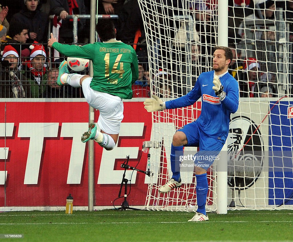 Edgar Prib (L) of Fuerth in action against Oliver Baumann during the Bundesliga match between SC Freiburg and SpVgg Greuther Fuerth at Mage Solar Stadium on December 8, 2012 in Freiburg, Germany.