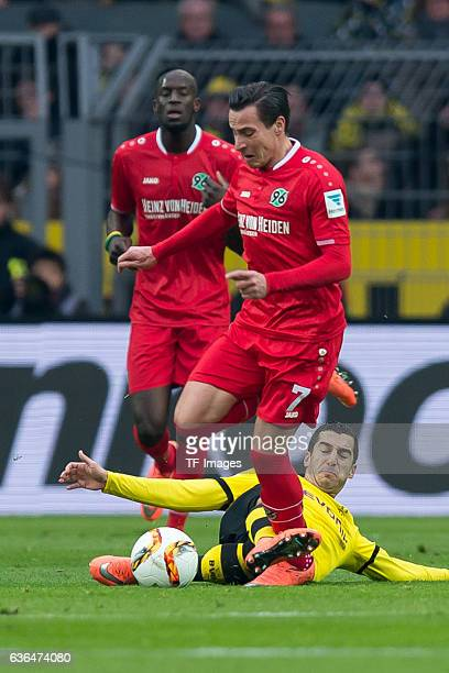 Edgar PRIB of Hannover 96 and Henrikh Mkhitaryan of Bosussia Dortmund battle for the ball during the Bundesliga match between Borussia Dortmund and...