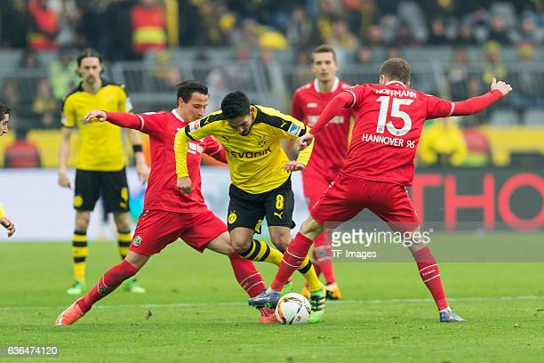 Edgar PRIB of Hannover 96 Ilkay Guendogan of Bosussia Dortmund and Andre HOFFMANN of Hannover 96 'n'n battle for the ball during the Bundesliga match...