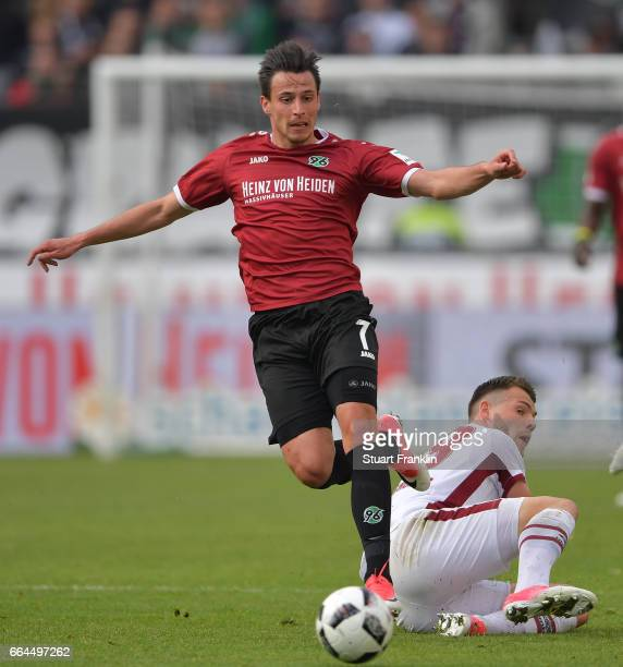 Edgar Prib of Hannover is challenged by Eduard Lwen of Nuernberg during the Second Bundesliga match between Hannover 96 and 1 FC Nuernberg at...
