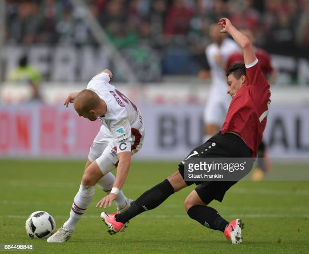 Edgar Prib of Hannover is challenged by Miso Brecko of Nuernberg during the Second Bundesliga match between Hannover 96 and 1 FC Nuernberg at...