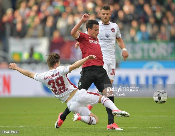 Edgar Prib of Hannover is challenged by Patrick Kammerbauer of Nuernberg during the Second Bundesliga match between Hannover 96 and 1 FC Nuernberg at...