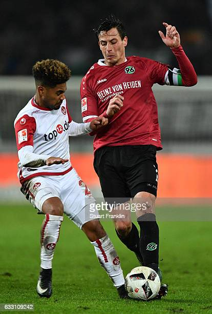 Edgar Prib of Hannover is challenged by Philipp Mwene of Kaiserslautern during the Second Bundesliga match between Hannover 96 and 1 FC...