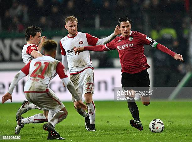 Edgar Prib of Hannover is challenged by Sebastian Kerk of Kaiserslautern during the Second Bundesliga match between Hannover 96 and 1 FC...