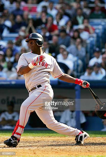 Edgar Renteria of the Boston Red Sox hits a single that scored two runners to give the Red Sox a 63 lead against the New York Yankees in the ninth...