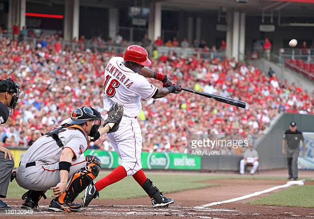 Edgar Renteria of the Cincinnati Reds hits a double during the game against the San Francisco Giants at Great American Ball Park on July 30 2011 in...