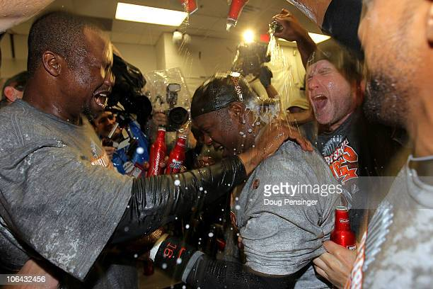 Edgar Renteria of the San Francisco Giants celebrates with his teammates in the locker room after the Giants won 31 against the Texas Rangers in Game...