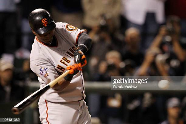 Edgar Renteria of the San Francisco Giants hits a 3run home run in the seventh inning against Cliff Lee of the Texas Rangers in Game Five of the 2010...