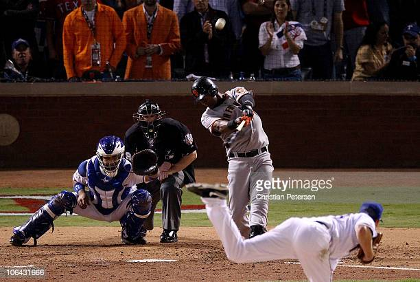 Edgar Renteria of the San Francisco Giants hits a 3run homer to centerfield against starting pitcher Cliff Lee of the Texas Rangers in the top of the...