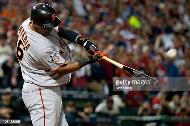 Edgar Renteria of the San Francisco Giants hits a threerun home run in the top of the seventh inning of Game Five of the 2010 World Series against...