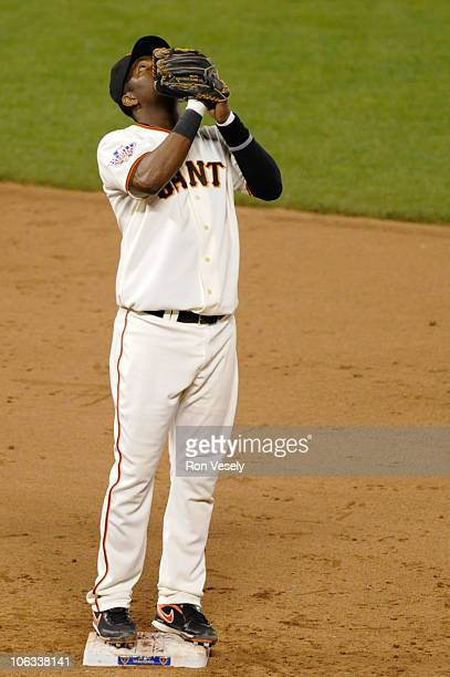 Edgar Renteria of the San Francisco Giants reacts after the Giants' victory in Game Two of the 2010 World Series against the Texas Rangers at ATT...