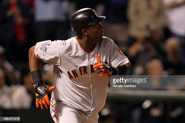Edgar Renteria of the San Francisco Giants watches the ball as he runs to first on his 3run home run in the seventh inning against Cliff Lee of the...