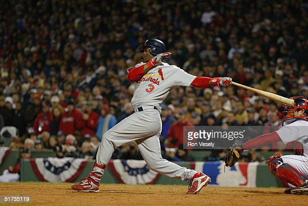 Edgar Renteria of the St Louis Cardinals singles in the eighth inning during game one of the 2004 World Series against the Boston Red Sox at Fenway...