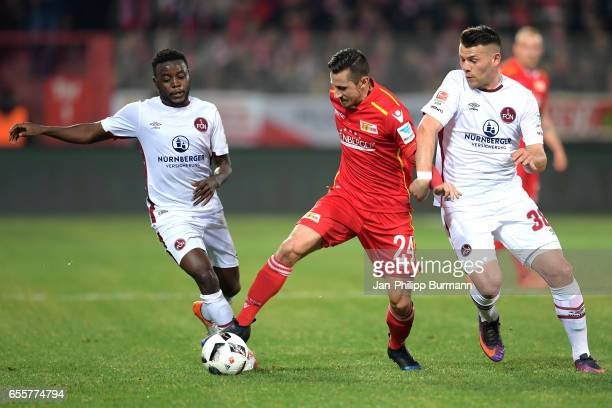 Edgar Salli Steven Skrzybski of 1 FC Union Berlin and Eduard Loewen of 1 FC Nuernberg during the game between 1 FC Union Berlin and 1 FC Nuernberg on...