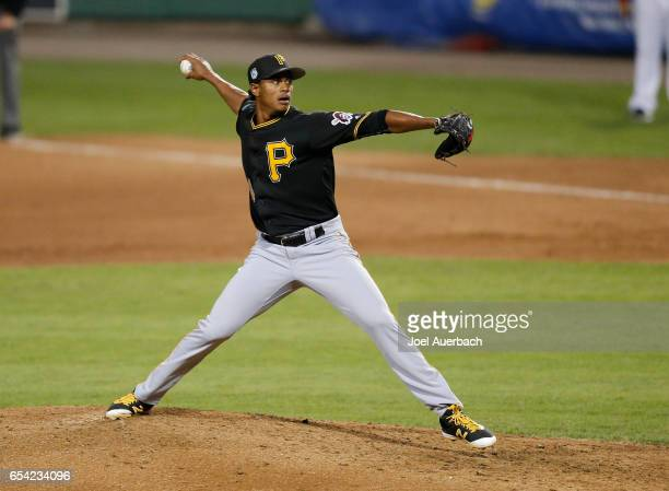 Edgar Santana of the Pittsburgh Pirates throws the ball against the Boston Red Sox in the sixth inning during a spring training game at JetBlue Park...