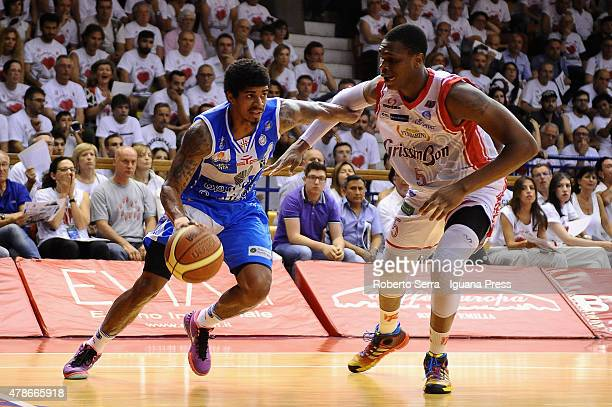 Edgar Sosa of Banco di Sardegna competes with Vitalis Chikoko of Grissin Bon during the match of LegaBasket Serie A playoff Final Game 7 between...
