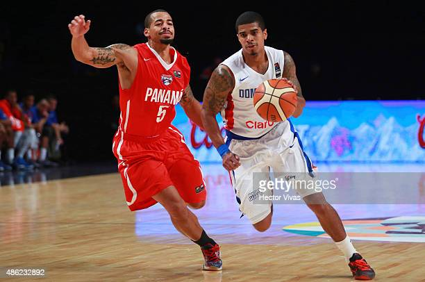 Edgar Sosa of Dominican Republic drives against Trevor Gaskins of Panama during a match between Dominican Republic and Panama as part of the 2015...