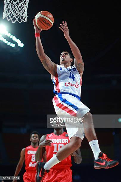 Edgar Sosa of Dominican Republic goes for the basket during a second stage match between Dominican Republic and Canada as part of the 2015 FIBA...