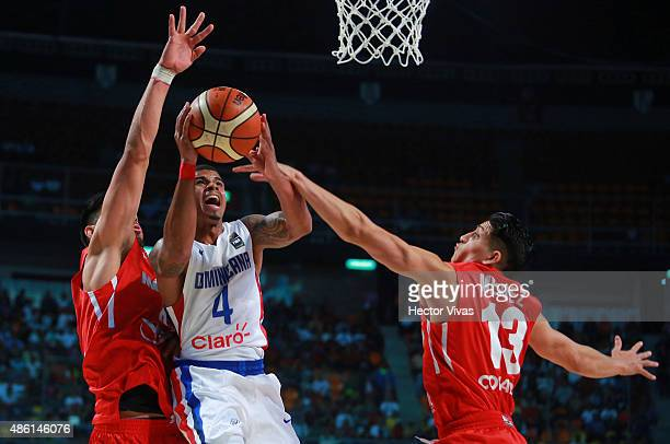 Edgar Sosa of Dominican Republic goes up against Orlando Mendez of Mexico during a match between Mexico and Dominican Republic as part of the 2015...