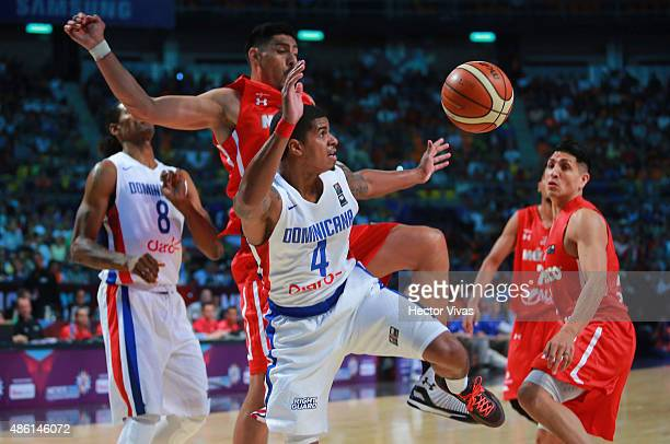 Edgar Sosa of Dominican Republic handles the ball against Gustavo Ayon of Mexico during a match between Mexico and Dominican Republic as part of the...