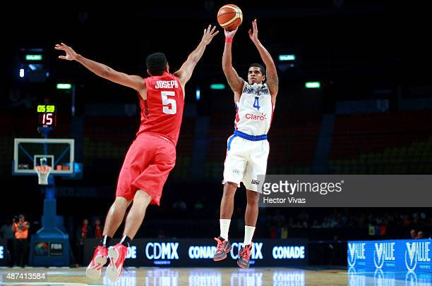 Edgar Sosa of Dominican Republic shoots as Cory Joseph of Canada tries to block during a second stage match between Dominican Republic and Canada as...