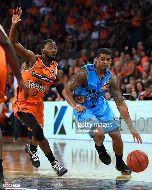 Edgar Sosa of the Breakers drives to the basket past Scoochie Smith of the Taipans during the round five NBL match between the Cairns Taipans and the...