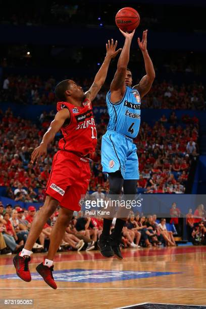 Edgar Sosa of the Breakers puts a shot up against Bryce Cotton of the Wildcats during the round six NBL match between the Perth Wildcats and the New...