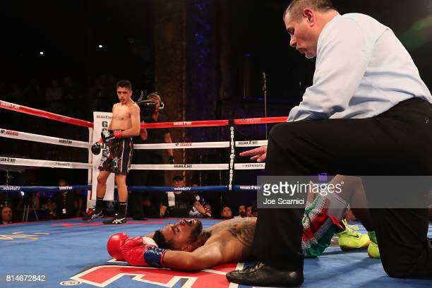 Edgar Valerio knocks down Jairo Ochoa in the first round during LA Fight Club at Belasco Theatre on July 14 2017 in Los Angeles California