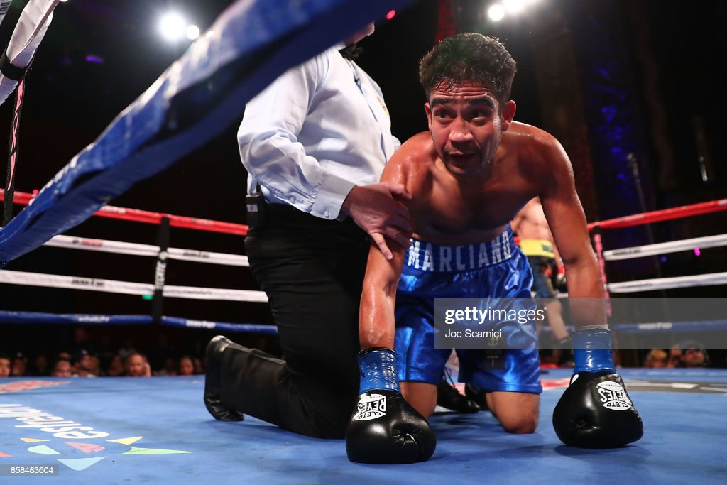 Edgar Valerio knocks down Martin Cardona in the second round of their Featherweight fight at Belasco Theatre on October 6, 2017 in Los Angeles, California.