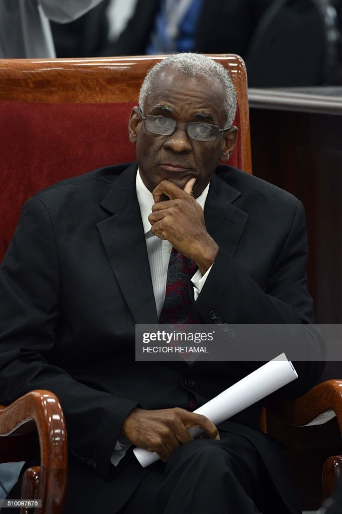 Edgard Leblanc, candidate for the provisional presidency, listens as Haitian lawmakers prepare to elect an interim president February 13, 2016 in Port-au-Prince. Haitian lawmakers were set to elect an interim president to fill the power vacuum following the departure of Michel Martelly, after a vote to choose his replacement was postponed over fears of violence. / AFP / HECTOR RETAMAL