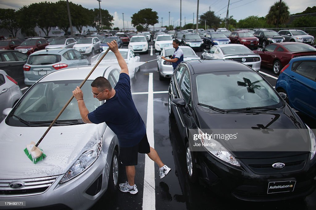 Edgardo Costanzo washes new cars on the sales lot of a Ford AutoNation car dealership on & Pick-Up Trucks Drive Ford Sales Up 12 Percent In August Photos and ... markmcfarlin.com
