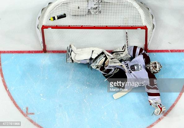 Edgars Masalskis goaltender of Latvia lies on the ice during the IIHF World Championship group A match between Austria and Latvia at o2 Arena on May...
