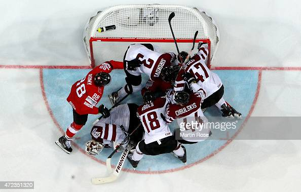 Edgars Masalskis goaltender of Latvia makes a save during the IIHF World Championship group A match between Switzerland and Latvia at o2 Arena on May...