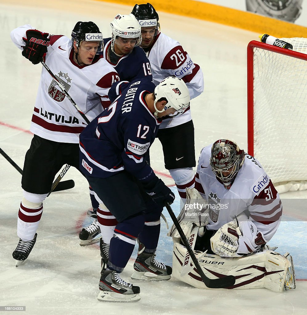 Edgars Masalskis (#31), goaltender of Latvia makes a save on Bobby Butler (#12) of USA battle during the IIHF World Championship group H match between Latvia and USA at Hartwall Areena on May 5, 2013 in Helsinki, Finland.