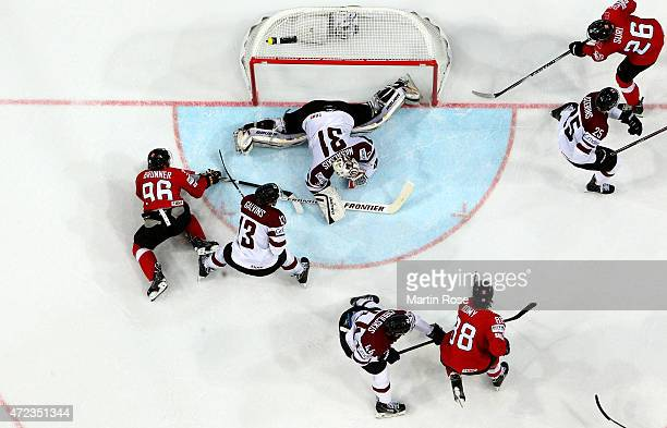 Edgars Masalskis goaltender of Latvia makes a save on Damien Brunner of Switzerland during the IIHF World Championship group A match between...