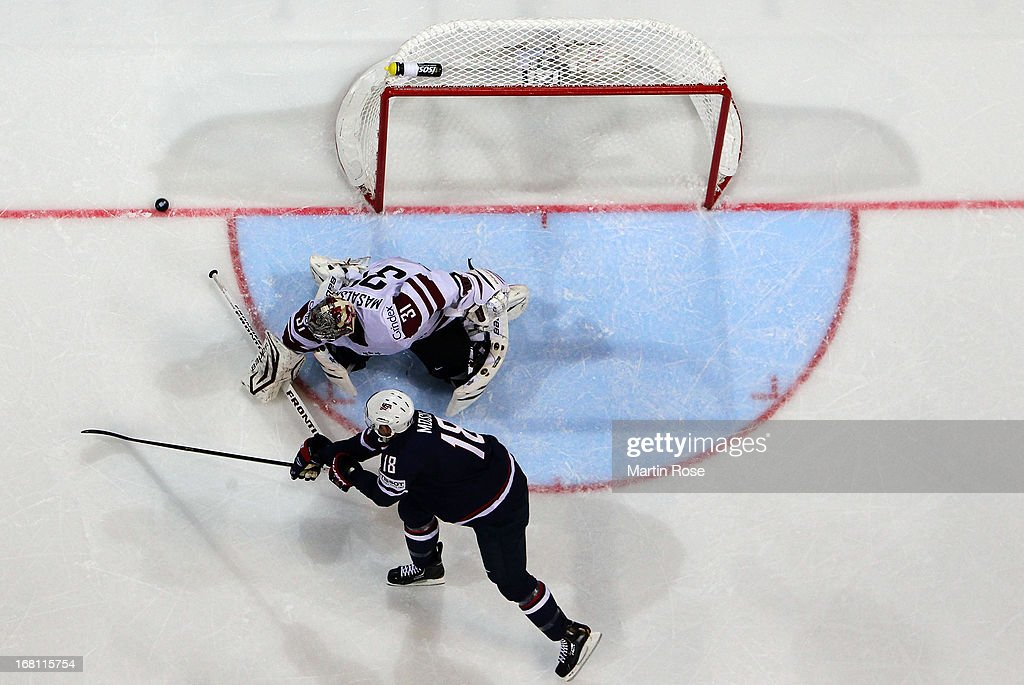 Edgars Masalskis (C), goaltender of Latvia makes a save on David Moss (#18) of USA during the IIHF World Championship group H match between Latvia and USA at Hartwall Areena on May 5, 2013 in Helsinki, Finland.