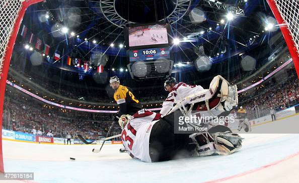 Edgars Masalskis goaltender of Latvia saves the shot of Nicolas Krammer of Germay during the IIHF World Championship group A match between Czech...