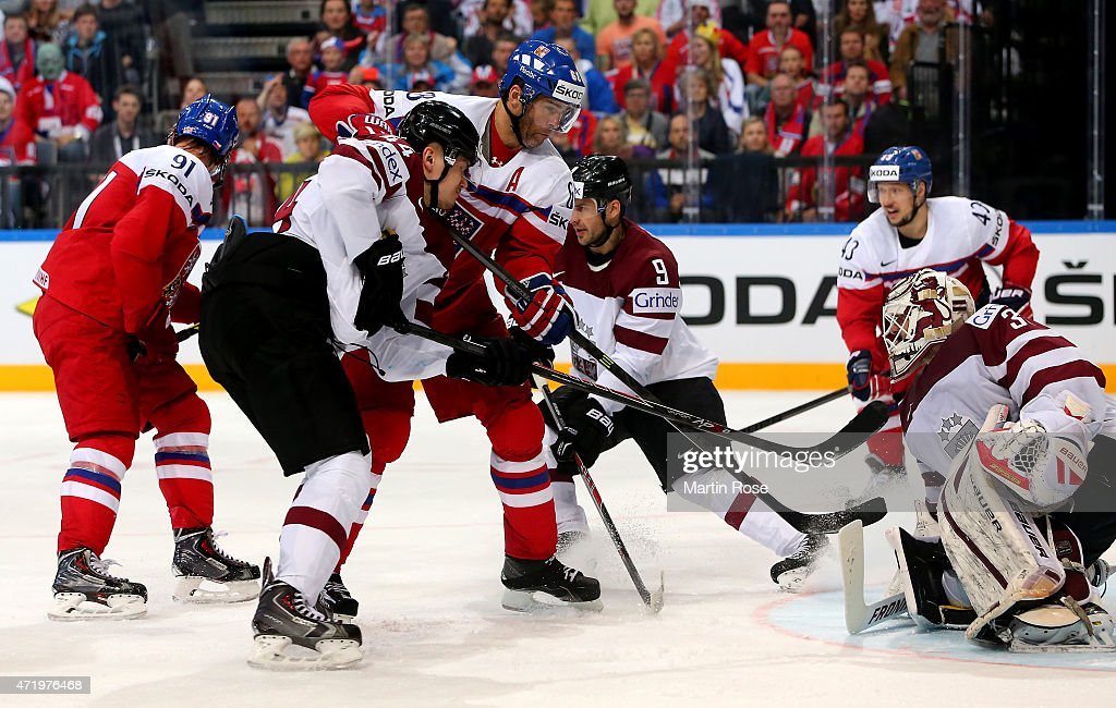 Edgars Masalskis (R), goaltender of Latvia saves the shot ofJaromir Jagr (C) of Czech Republic during the IIHF World Championship group A match between Latvia and Czech Republic at o2 Arenaon May 2, 2015 in Prague, Czech Republic.
