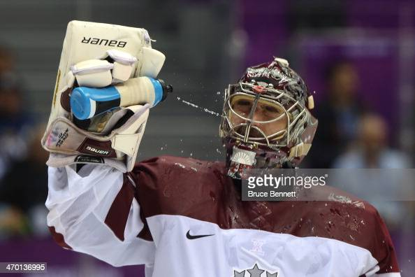 Edgars Masalskis of Latvia looks on against Switzerland during the Men's Ice Hockey Qualification Playoff game on day eleven of the Sochi 2014 Winter...