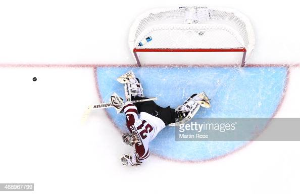 Edgars Masalskis of Latvia makes a save in the second period against the Switzerland during the Men's Ice Hockey Preliminary Round Group C game on...