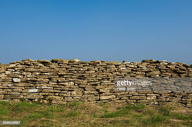 Edge of field and traditional Cotswold dry limestone wall