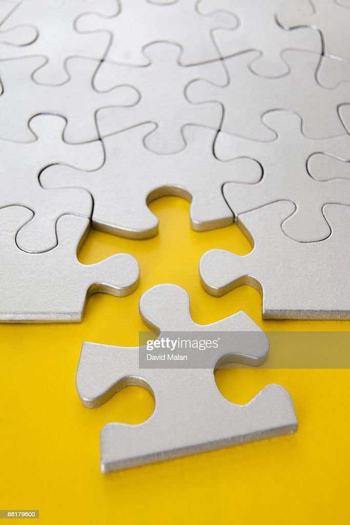 edge piece of puzzle next to it's space : Stock Photo