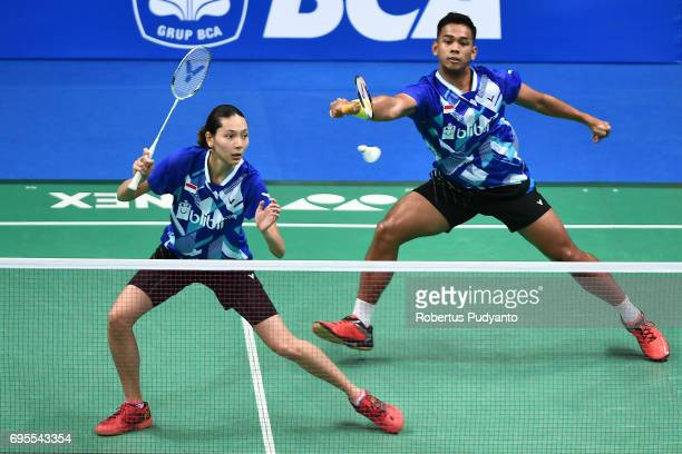 Edi Subaktiar and Gloria Emanuelle Widjaja of Indonesia compete against Yuta Watanabe and Arisa Higashino of Japan during Mixed Doubles Round 1 match...