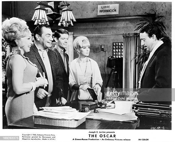 Edie Adams Ernest Borgnine Stephen Boyd and Elke Sommer in a scene from the film 'The Oscar' 1966