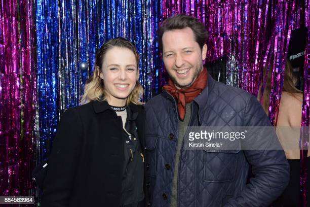 Edie Campbell and Derek Blasberg attend the Burberry x Cara Delevingne Christmas Party on December 2 2017 in London England