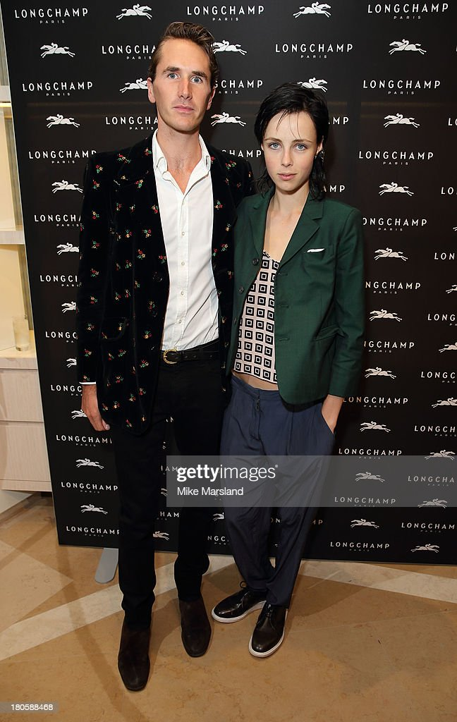 Edie Campbell and <a gi-track='captionPersonalityLinkClicked' href=/galleries/search?phrase=Otis+Ferry&family=editorial&specificpeople=178981 ng-click='$event.stopPropagation()'>Otis Ferry</a> attend the grand opening party of Longchamp Regent Streetat Longchamp on September 14, 2013 in London, England.