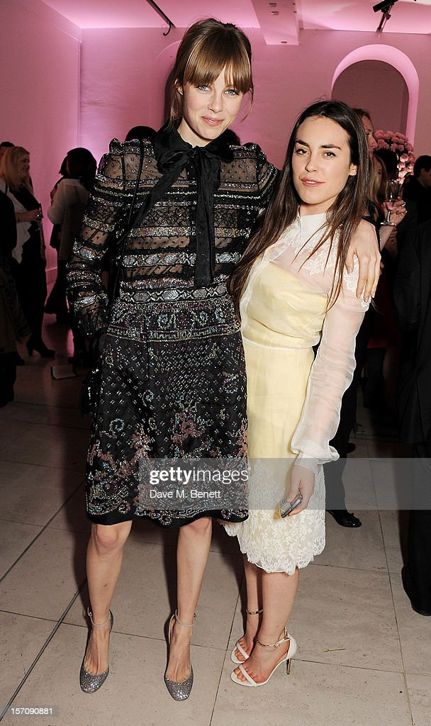 Edie Campbell (L) and Tallulah Harlech attend a private view of 'Valentino: Master Of Couture', exhibiting from November 29th, 2012 - March 3, 2013, at Somerset House on November 28, 2012 in London, England.